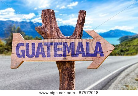 Guatemala wooden sign with road background