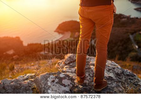 Men's legs on the mountain