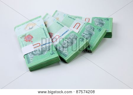 four stacks of the Malaysia ringgit five dollar