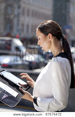 Young Beautiful business woman reading notepad