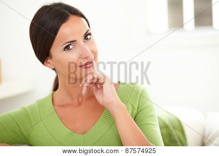 Woman With Hand On Chin Looking At Camera