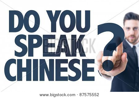 Business man pointing the text: Do You Speak Chinese?