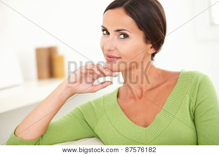 Young Woman Contemplating And Looking At Camera