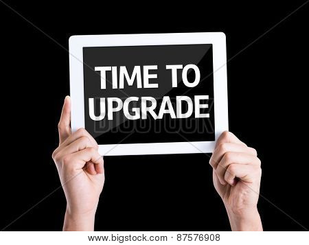 Tablet pc with text Time To Upgrade isolated on black background