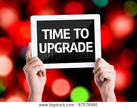 Tablet pc with text Time To Upgrade with bokeh background