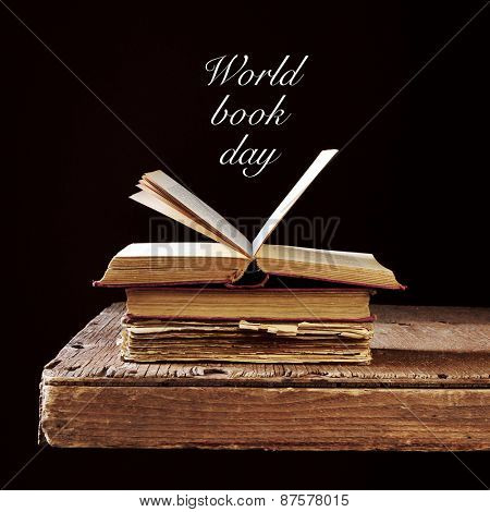 some old books on a rustic wooden table and the text world book day written in white on a black background