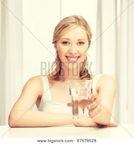 closeup of young smiling woman with glass of water
