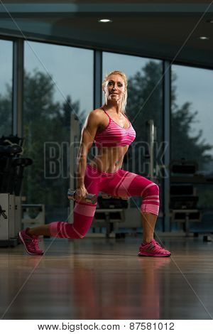 Mature Woman Doing Exercise Dumbbell Squat