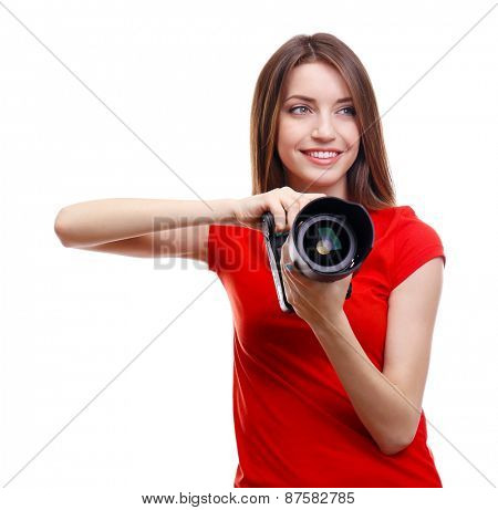 Young female photographer taking photos isolated on white