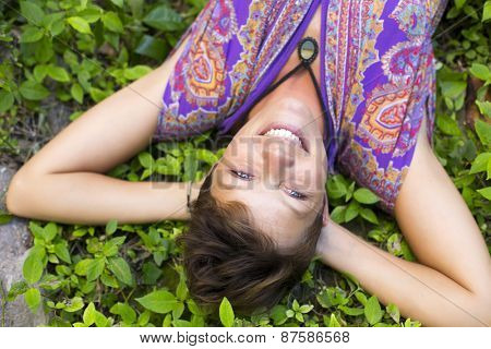 Woman lying on the grass daydreaming
