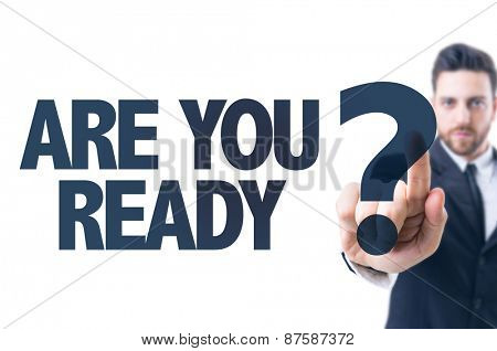 Business man pointing the text: Are You Ready?