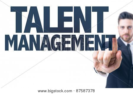 Business man pointing the text: Talent Management