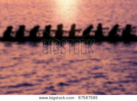 Blurred Background Of Rowers At Sunset