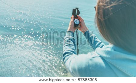 Traveler Woman Holding A Compass On Coast
