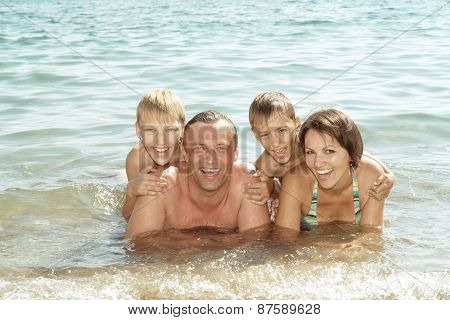 friendly family swimming