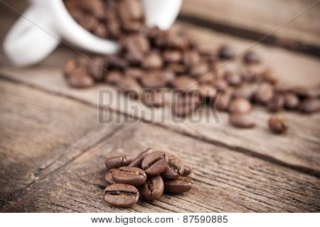 Coffee beans on aged wooden background