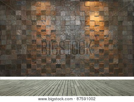 Stone wall with two spotlights and grey wooden floor panels