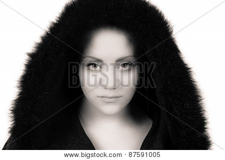 Woman Looking Straight Into The Camera With A Serious Look
