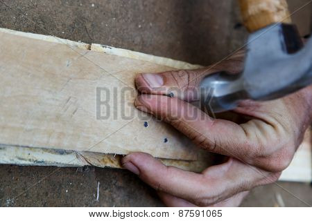 Man Hand Working On Wood With A Hammer -serial-