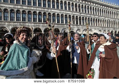 Persons In Franciscan Monks Carnival Costume On San Marco Square, Venice, Italy.