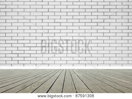 Room with brick wall and wooden floor