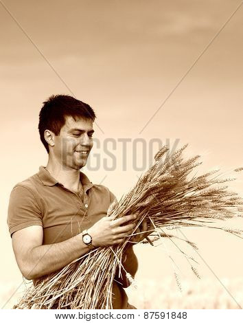Farmer With Ripe Wheat