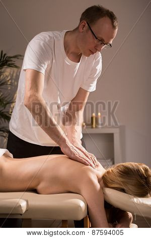 Physiotherapist Massaging Beauty Woman