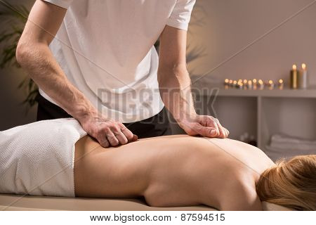 Therapist Massaging Female Back