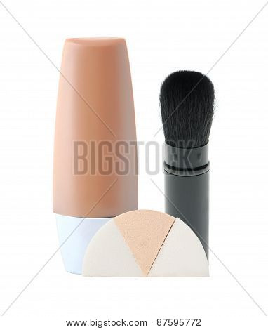 Liquid Makeup Foundation In Tube, Brush And Sponges Isolated On White Background