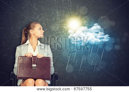 Businesswoman with Case Looking at Rain Cloud