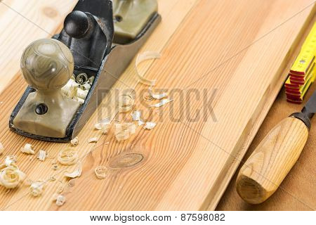 Plane On Wooden Table With Shavings