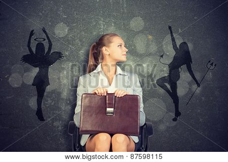 Businesswoman Framed by Shadow of Angel and Devil