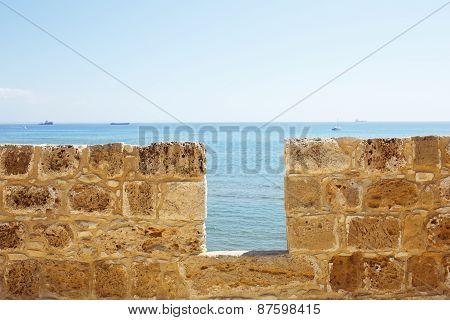 Limestone fort wall close-up. Sea view.