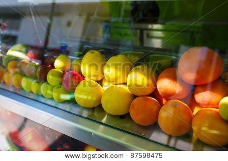 Fresh fruits for juice at the market. Display window