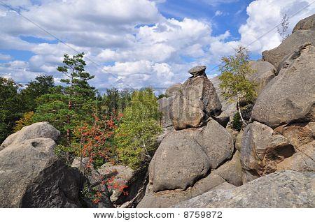 Rocks over wood.