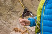 pic of mountain-climber  - The young man in the mountains insures climber - JPG