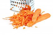 picture of metal grate  - A pile of grated fresh carrots and two whole carrots - JPG
