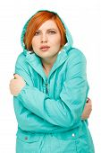 stock photo of shivering  - portrait of a girl in a jacket with a trembling from the cold Isolated on white background - JPG