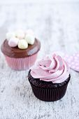 image of cupcakes  - cupcakes on a white wooden table background - JPG