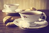 Постер, плакат: Old fashioned Image With Two Cups Of Tea Vintage Effect