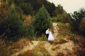 foto of greek-island  - portrait of a bride and groom in a greek island on their wedding day - JPG