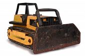 foto of bulldozers  - Shot of a toy bulldozer isolated over white - JPG