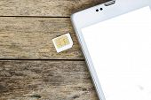image of micro-sim  - smart phone use with micro sim card white screen - JPG