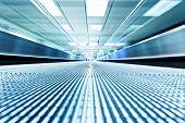 foto of escalator  - symmetric moving blue escalator inside contemporary airport - JPG