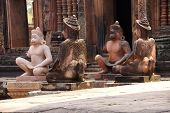 stock photo of guardian  - Monkey guardians outside temple at Banteay Srei Cambodia - JPG