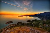 stock photo of sea-scape  - Beautiful landscape of Adriatic sea and mountains coast in Montenegro on the sunset - JPG