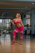 stock photo of hula hoop  - Middle Age Womane Playing Around With Hula Hoop Rings - JPG