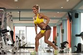 stock photo of kettles  - Middle Age Womane Working Out With Kettle Bell As Part Of Bodybuilding Training - JPG