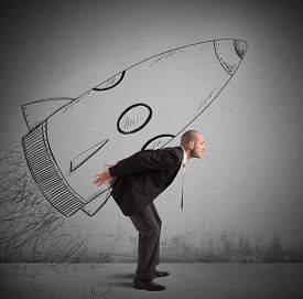 image of spaceships  - Businessman dreams to achieve success with spaceship - JPG