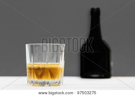 glass and bottle of whiskey